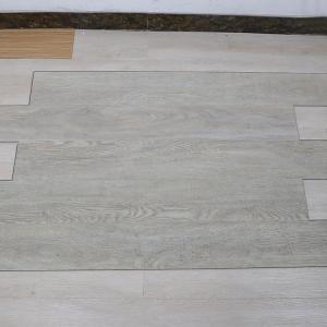 Best non deformation wood grain uv coating embossed PVC vinyl flooring planks wholesale