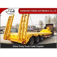 Quality Tri Axle Low Bed Semi Truck Trailer For Sale 60 Ton Heavy Machine Transport wholesale